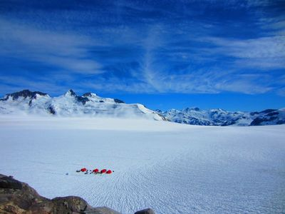 The huge scale of the Franklin glacier dwarfs a perimeter camp, photo Alice Hill
