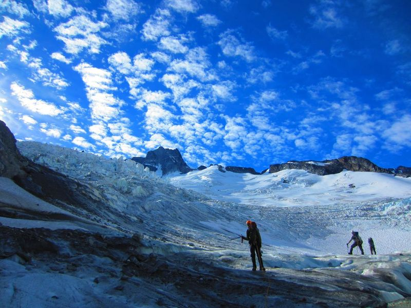 Diogo Fernandez, Conner Hagen, and Jay Rex travelling through firn zone on the Bell Glacier. Photo by Alice Hill